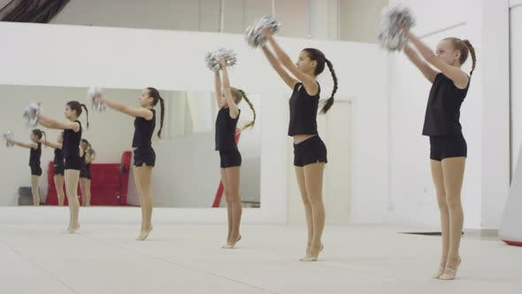 Thumbnail for Group of Girls Doing Cheerleading Jump Together