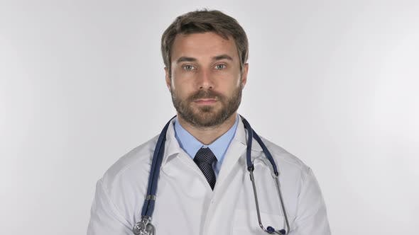 Thumbnail for Doctor Looking at Camera in Studio on White Background