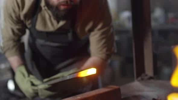 Thumbnail for Blacksmith Melting Billet in Coals