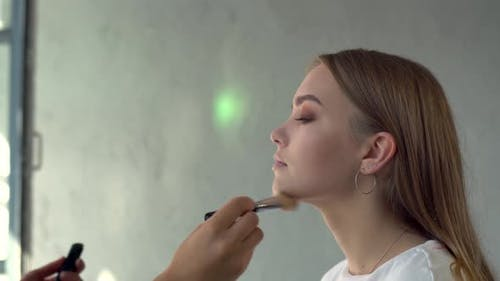 Makeup Artist Wearing Mask at Work Applying Model Makeup