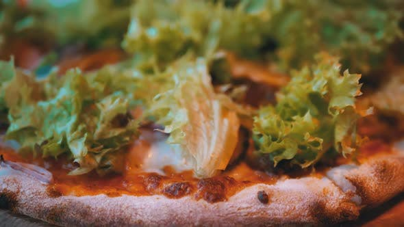 Thumbnail for Pizza on a Wooden Tray on a Table in a Restaurant Close-up. Detailed View of Ingredients
