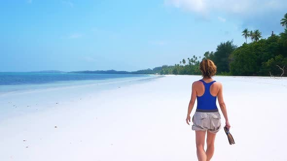 Cover Image for Slow motion: woman on white sand beach turquoise water tropical coastline