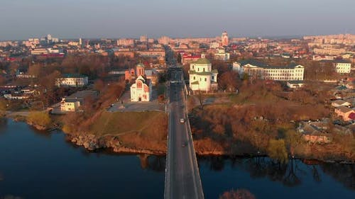 Aerial Shot of Bridge Over River and Two Churches in Small European City