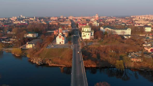 Thumbnail for Aerial Shot of Bridge Over River and Two Churches in Small European City