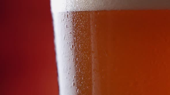 Thumbnail for Craft Light Beer in Glass with Condensate and Water Drops. Rotating Over Dark Background