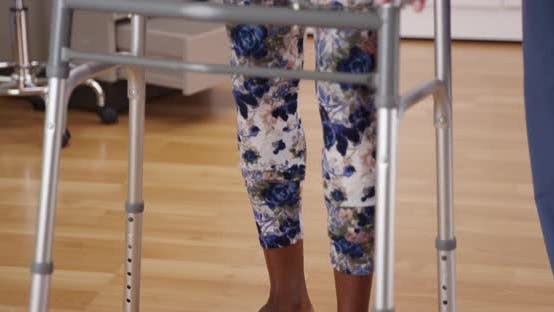 Thumbnail for Close up of black female patient using crutches to support herself walking