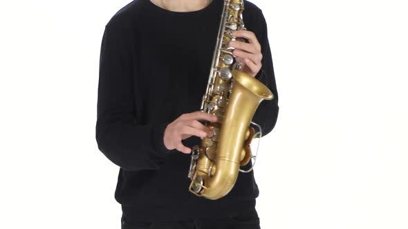 Thumbnail for Playing the Saxophone in the Performance a Young Male Musician