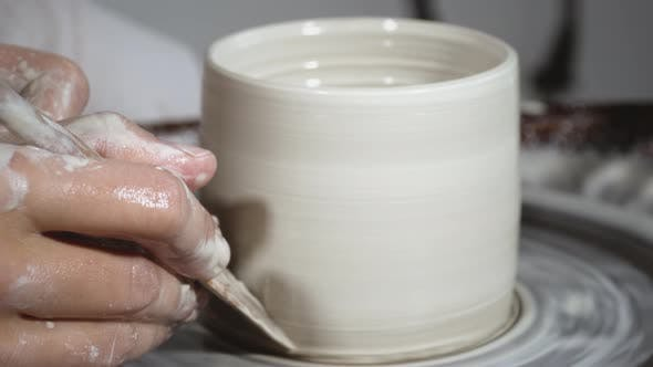 Thumbnail for Moulding a clay pot on pottery wheel