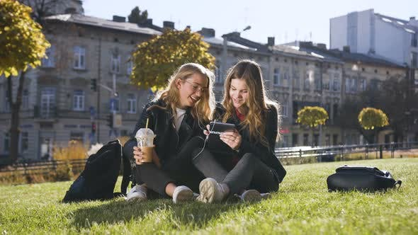 Cover Image for Teen Girlfriends Using the Tablet Computer Laughing at Fun Pictures
