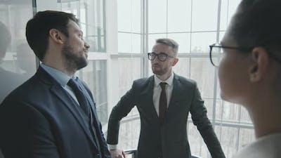 Team of Lawyers Talking in Elevator