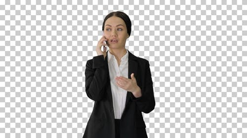 Young Businesswoman talking on her phone, Alpha Channel