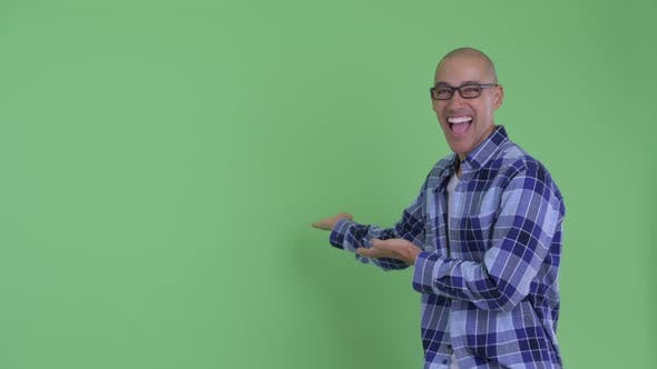 Thumbnail for Happy Bald Hipster Man Showing To Back and Looking Surprised