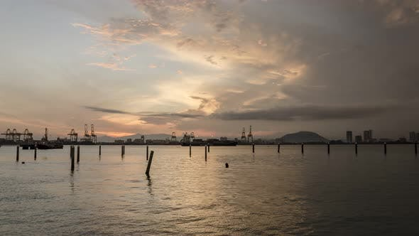Timelapse sunrise of Butterworth Port with Bukit Mertajam hill as background.