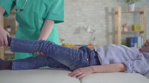 Little Boy with Leg Pain at Physiotherapist's Appointment