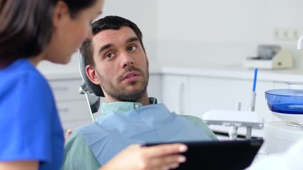 Thumbnail for Dentist and Patient Discussing Dental Treatment