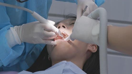 Thumbnail for Woman undergo dental check up at dental clinic