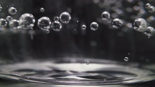 Glass Cup of Sparkling Vitamin Water with Numerous Bubbles