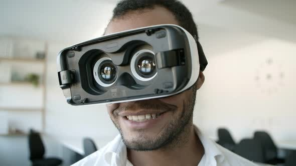 Thumbnail for Front View of Smiling Man Experiencing New VR Glasses