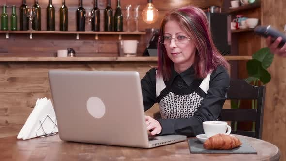 Thumbnail for Adult Woman Pays with NFC Payments in a Vintage Coffee Shop