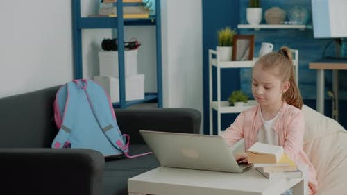Cheerful Girl Looking at Laptop Screen for Online Remote Classes