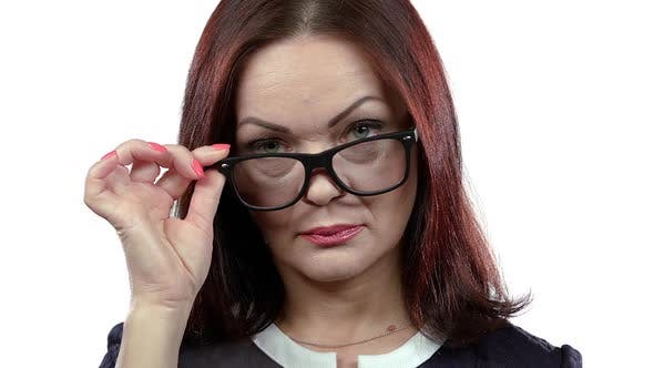 Thumbnail for Middle Aged Woman with Spectacles Flirts in Embarrassment. White Background