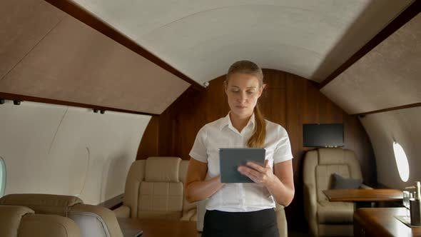 Thumbnail for Business Woman in Air Private Jet Surfing Internet on tabletPC