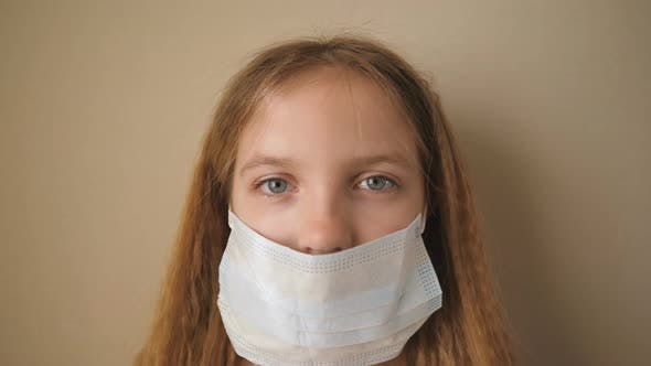 Thumbnail for Portrait of Little Girl with Medical Face Mask During Self Isolation. Sad Female Child Wear