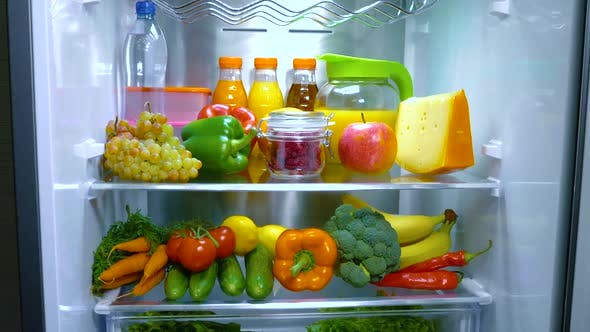Cover Image for Open Refrigerator Filled with Food