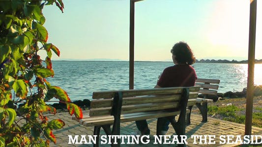 Thumbnail for Man Sitting Near the Seaside 3