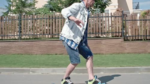 Active Senior Adult Trying to Longboard
