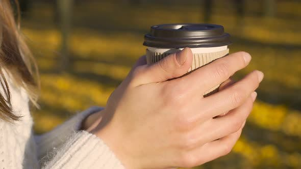 Thumbnail for Girl Warming Hands and Drinking Coffee Alone