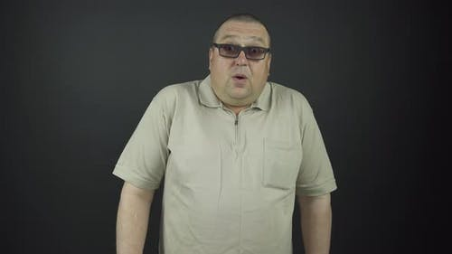 Fat Man in Brown Glasses Demonstrates Surprise Emotions