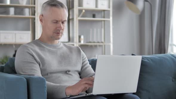 Thumbnail for Headache, Tired Gray Hair Man Using Laptop