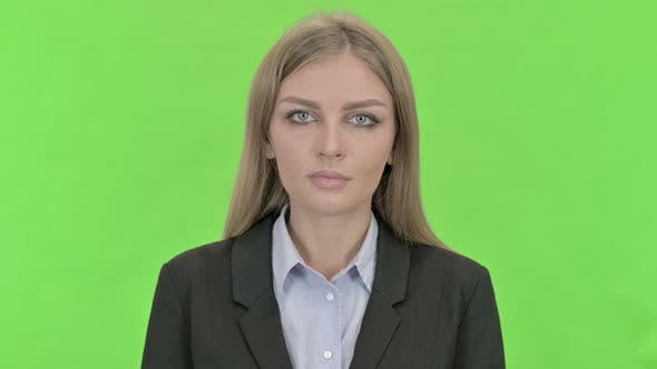 Thumbnail for Young Businesswoman Looking at Camera Against Chroma Key