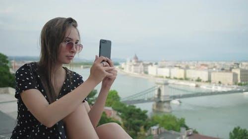 Girl Taking Selfie Against Budapest Cityscape Hungary