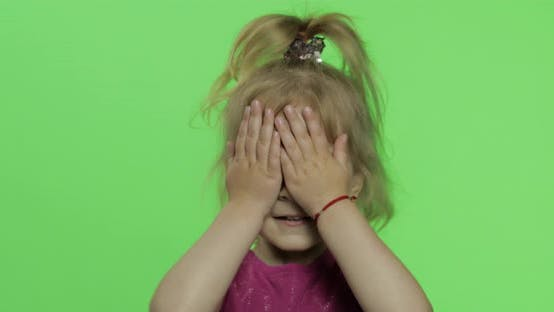 Child Portrait in Purple Dress. Hides Her Face with Hands and Sculps. Chroma Key
