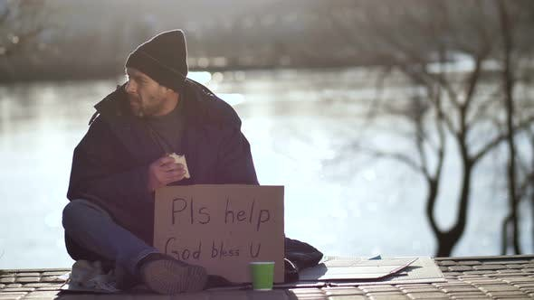Thumbnail for Homeless Man Eating Sandwich and Begging for Help