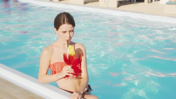 Thumbnail for Gorgeous Woman Enjoying Cocktail at the Swimming Pool