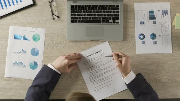 Thumbnail for Male in Classic Suit Reading and Signing Business Contract, Office Work, Deal