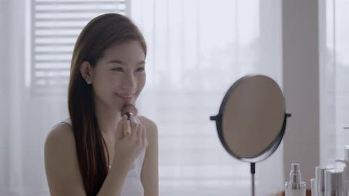 Beauty Asian woman make up face in morning.