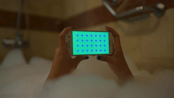 Thumbnail for Girl Use Mobile Phone in Foam Bath Horizontal