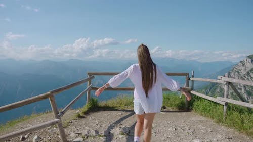 Girl Walks From Behind on the Italian Alps Mountains