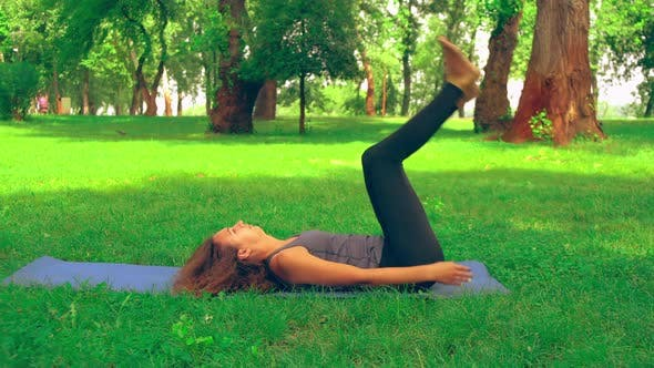 Thumbnail for Caucasian Female Doing Yoga Outdoor