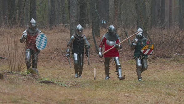 Thumbnail for Four Men Knightes Walking in the Row in the Forest in Full Armour