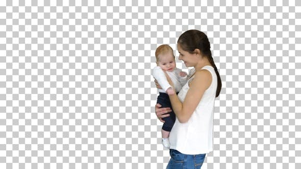 Thumbnail for Young mother holding her baby in hands and walking, Alpha Channel