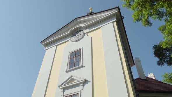 Thumbnail for A Detail of a Front Tower of a Historic Church Outside, By a Park, with a Green Tree Next To It