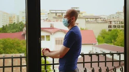 Man During Self Isolation Sitting on the Balcony