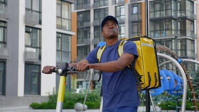 Afroamerican Man Courier Food Delivery Looks Around Looking Delivery Address