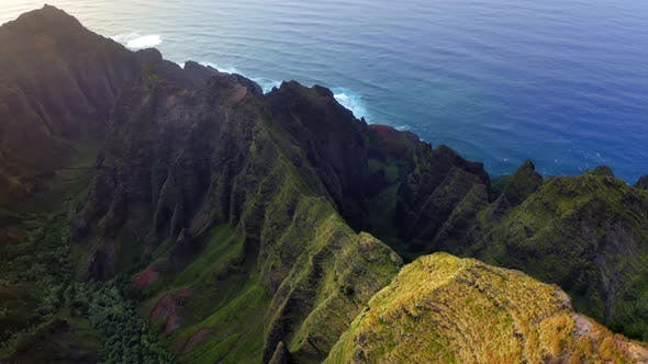 Thumbnail for Grassy Rocks of Mountainous Coastal Terrain of Hawaii Illuminated By Sunset Light, Aerial Shot