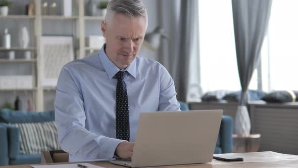 Thumbnail for Loss, Frustrated Gray Hair Businessman Working on Laptop